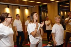 Happy participants in yoga classes