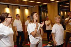 Happy participants in yoga classes