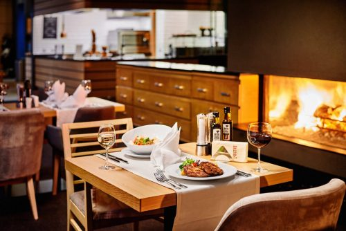 Beautiful fireplace in Le Bistro | Lucky Bansko